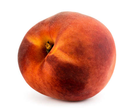 Ripe peach close up on a white background.