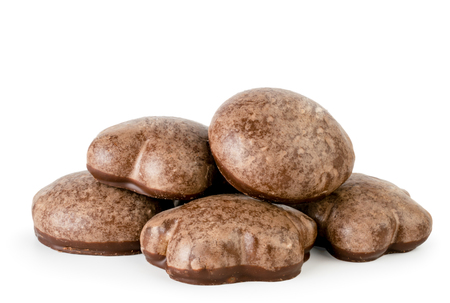 A bunch of chocolate gingerbread on a white background.