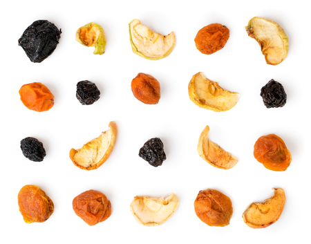 Dried fruit laid out on a white. The view from the top.