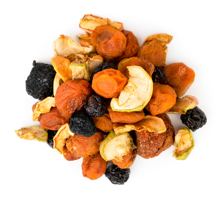 A bunch of dried fruits on a white. The view from the top.