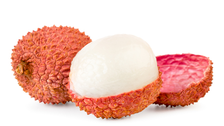 Ripe lychee cleaned half on a white, isolated. Reklamní fotografie