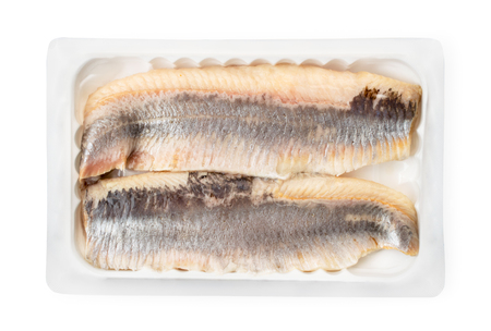 Herring fillet in a pack on a white. The form of the top. Reklamní fotografie