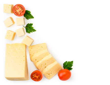 Cheese sliced with tomatoes and parsley leaves on a white. The form of the top.