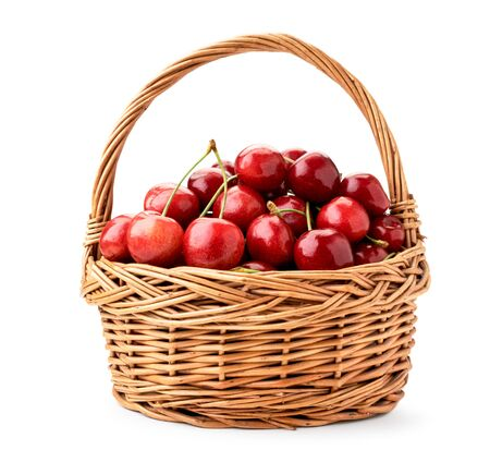 Basket of ripe cherries closeup on a white background. Isolated.