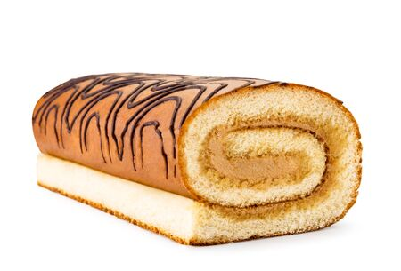 Biscuit roll cake closeup on a white. Isolated 版權商用圖片