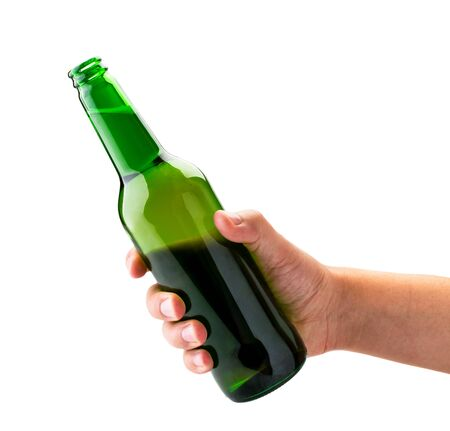 Bottle of beer in a mans hand carved on a white background.