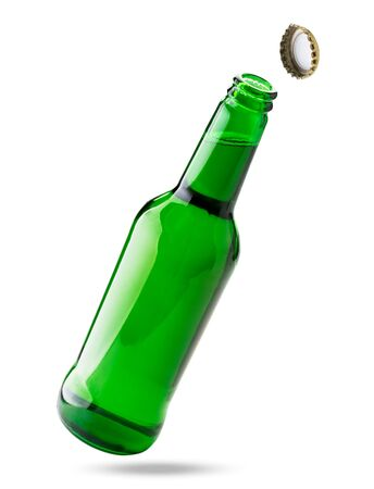 Open bottle of beer flies in the air on a white. Isolated. Banco de Imagens
