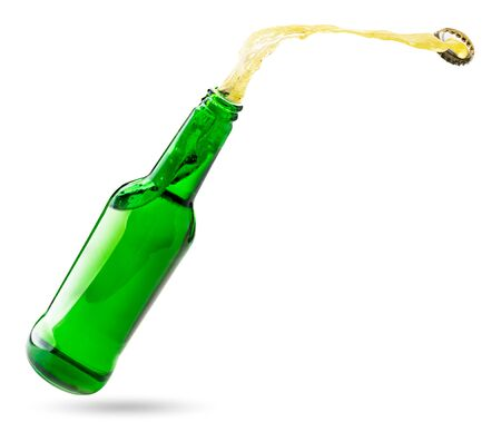 Open bottle with splashes of beer isolated on a white background. Banco de Imagens