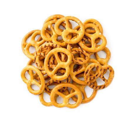 Heap of pretzels with salt on a white. The view of the top.