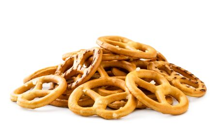 Pile of mini pretzels close-up on a white background. Isolated Banco de Imagens - 129551969