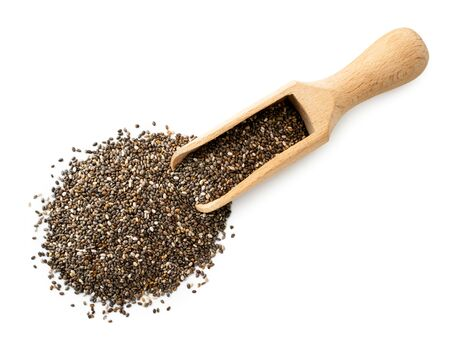 Chia seeds spilled from a wooden spoon on a white background. The view of the top. Banco de Imagens - 129551981