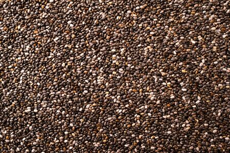 Chia seeds close-up, background. The view of top.