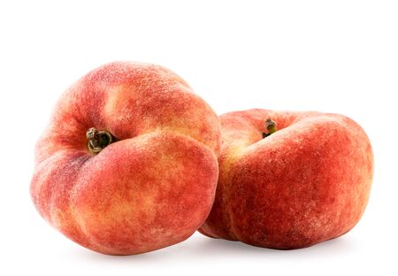 Two flat peaches on a white background, isolated. Banco de Imagens