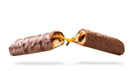 Caramel chocolate bar broken in half on a white, isolated. Banco de Imagens - 129552609