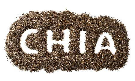 Chia seeds are scattered around the text on a white background. The view of top. Banco de Imagens - 129552629