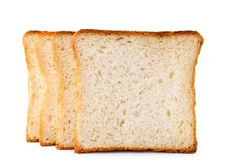 Toast bread stands in a row on a white, isolated. Banco de Imagens - 129552653