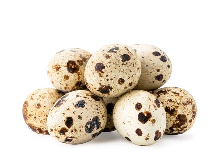Pile of quail eggs on a white, isolated.