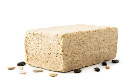 Halva with sunflower seeds closeup on a white. Isolated Banco de Imagens - 129552932