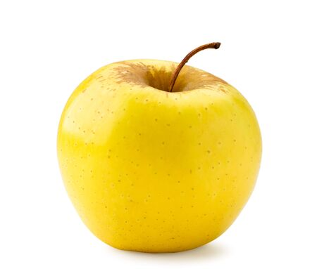 One yellow Apple close-up on a white. Isolated Banco de Imagens