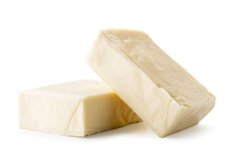 Two pieces of cream cheese rectangular on a white, isolated. Stock Photo