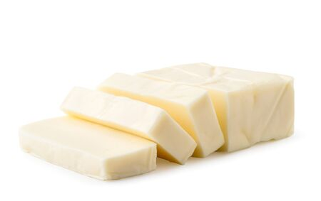 Cream cheese rectangular shape cut into pieces on a white, isolated.