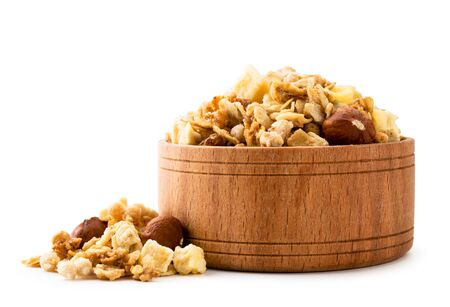 Granola with nuts in a wooden plate close-up on a white. Isolated Banco de Imagens - 129553055