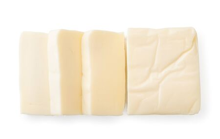 Cream cheese rectangular shape on a white. The view of the top.