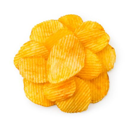 Pile of corrugated chips on a white background. The view of the top. Banco de Imagens
