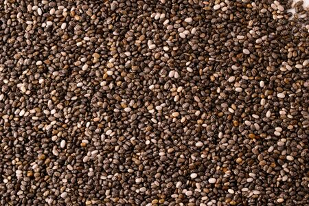 Chia seeds background. The view of the top. Banco de Imagens