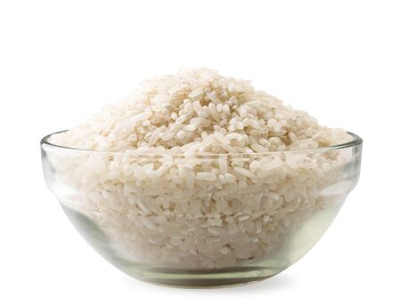 Rice groats in a glass plate on a white background. Isolated Banco de Imagens - 131761998