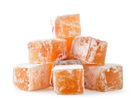 Pile of turkish delight cubes on a white, isolated. Banco de Imagens - 131762043
