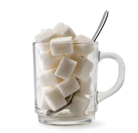 Refined sugar in a glass with spoon on a white, isolated.