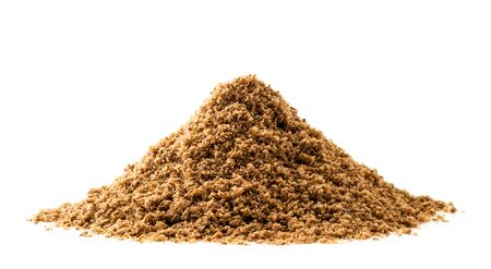 Pile of ground flax on a white background.
