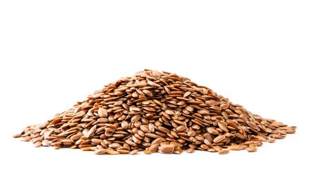 Pile of flax seeds close up on a white background. Isolated.