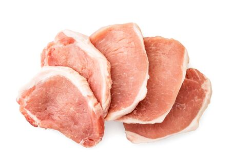 Pieces of raw meat with a layer of fat on a white background. The view of the top.