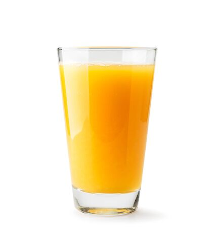 Orange juice in a glass close-up on a white background. Isolated