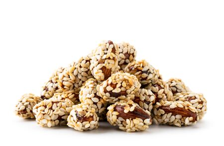 Almond covered sesame seeds closeup on a white background. Isolated.