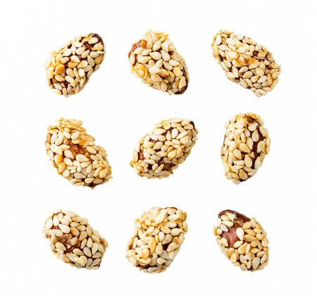 Set of almonds covered sesame seeds on a white, isolated. The view of the top.