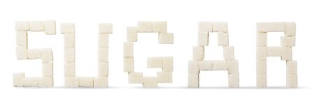 Cubes of refined sugar text on a white background, isolated.