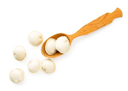 Dumplings spilled from a wooden spoon on a white. The view of the top. Stok Fotoğraf - 132913402