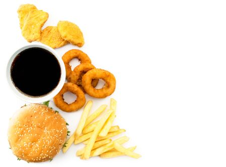Fast food on a white, place for text. Hamburger, french fries, drink and nuggets view top. Stok Fotoğraf - 132411519
