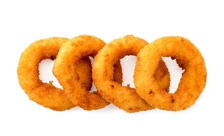 Onion rings lie flat on a white background. The view of the top. Stok Fotoğraf - 132411461