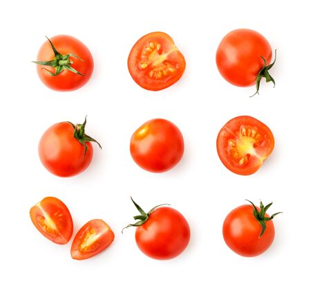 Set of cherry tomatoes, halves and pieces on a white. The view of the top. Stok Fotoğraf - 132913436