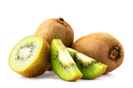 Ripe kiwi with half and pieces on a white, isolated.