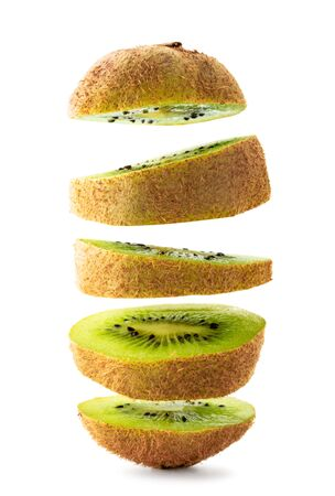 Kiwi cut into pieces flying on a white, isolated. Stok Fotoğraf