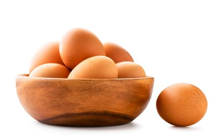 Chicken eggs in a wooden plate on a white background. Isolated. Stok Fotoğraf - 132802679