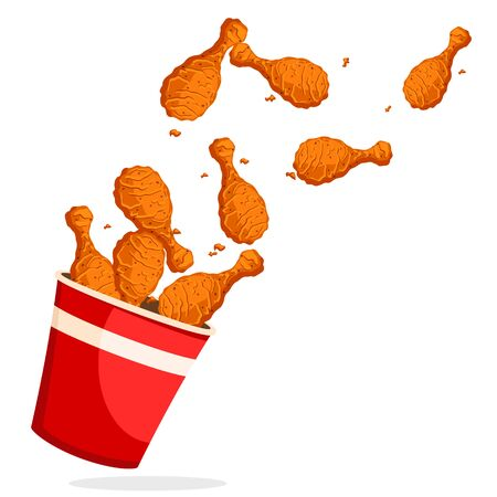 Fried chicken legs flew out of the bucket on a white background. Banco de Imagens
