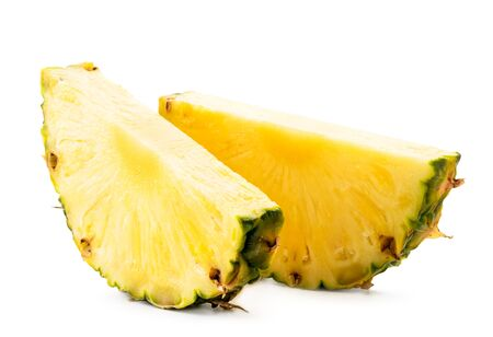 Two pieces of ripe pineapple close-up on a white background. Isolated Stok Fotoğraf - 132883118