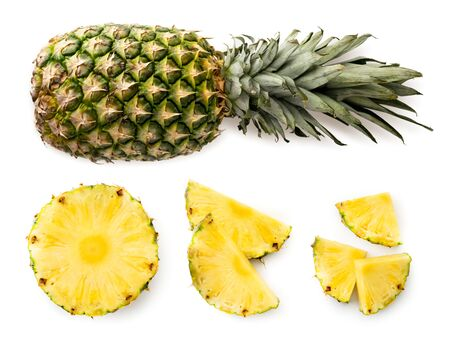 Ripe pineapple, half and clippers set on a white background. The view of the top.