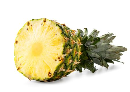 Half ripe pineapple with leaves close up on a white background. Isolated. Stok Fotoğraf - 133065614